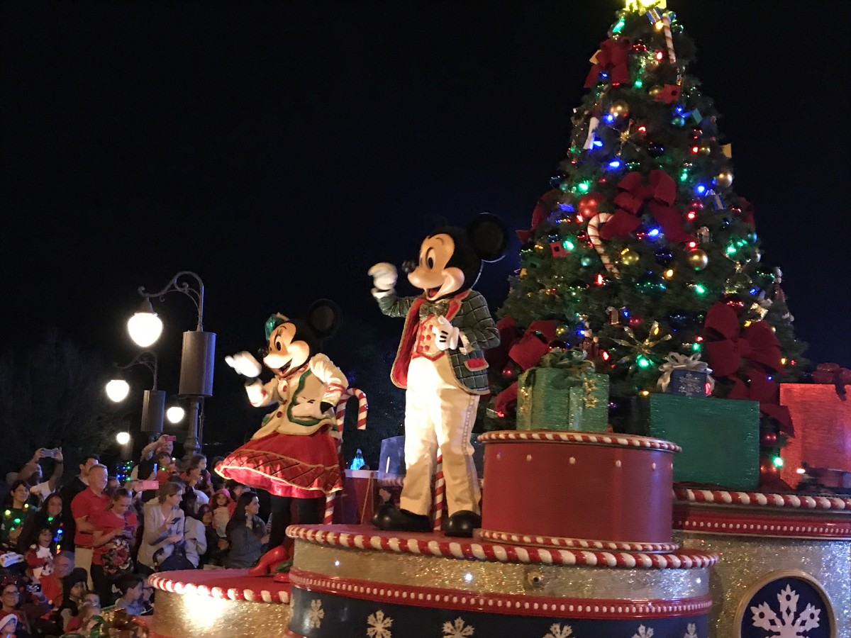 Mickey and Minnie Mouse waving from their float during the parade at Mickey's Very Merry Christmas Party