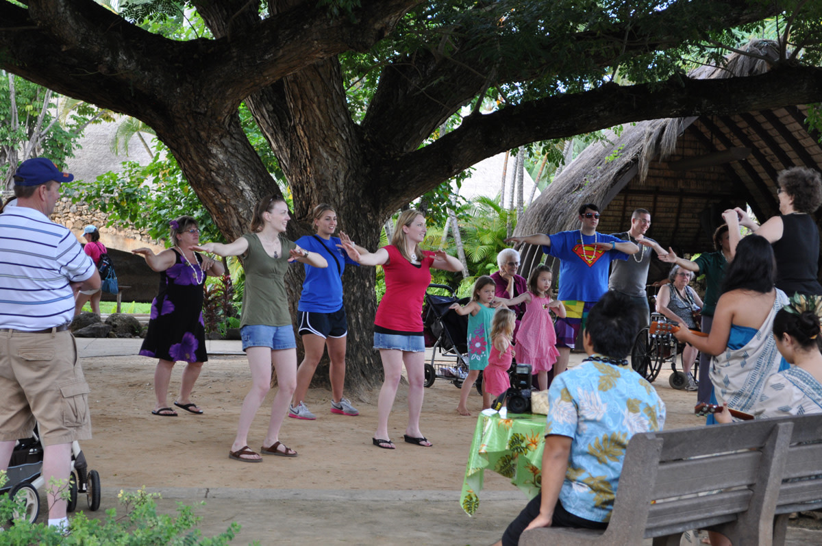 Guests participate in complimentary hula lessons at the Polynesian Cultural Center