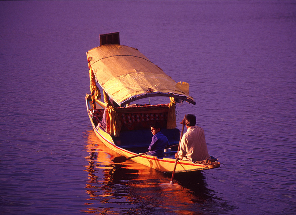Tourist having a Shikara ride through the Dal Lake.