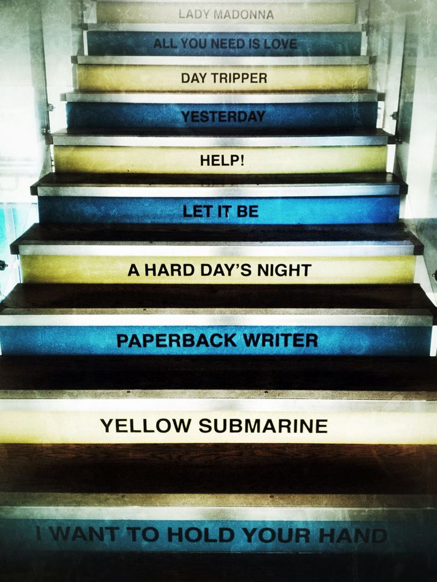 This staircase leads to the FAB4 Cafe and Merch store in the Pier Head's Mersey Ferries Terminal.