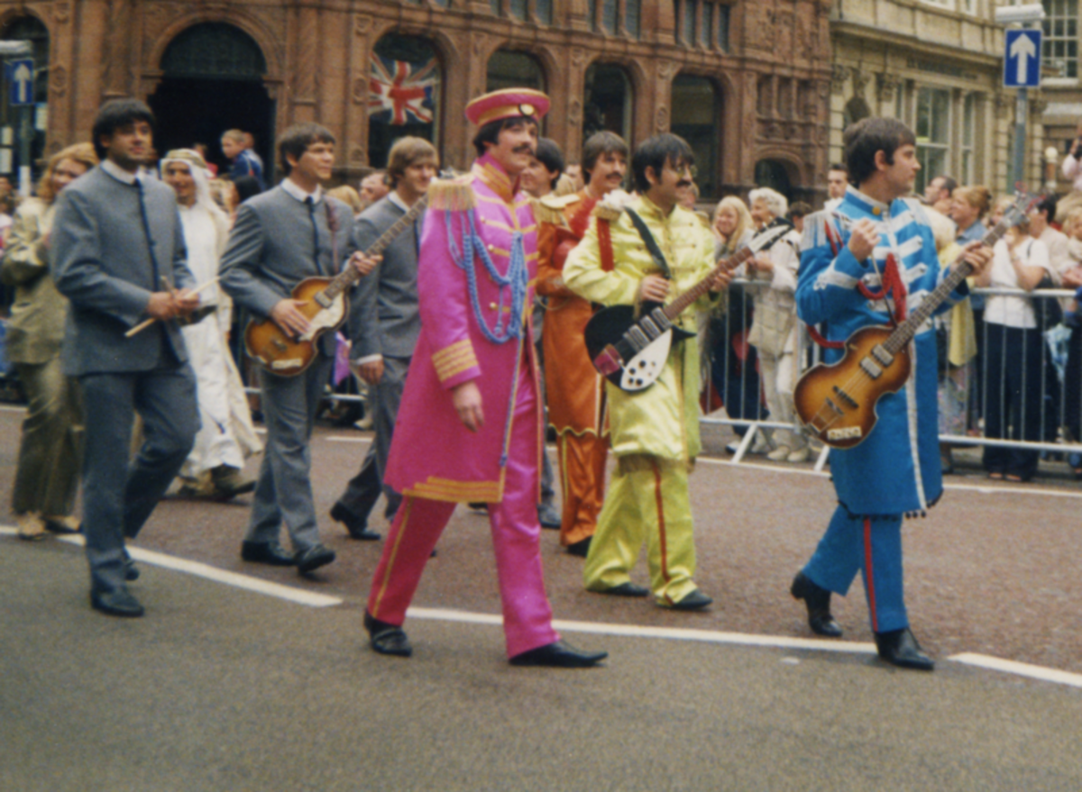 I found this picture of Beatles impersonators at a parade in Liverpool on Wikimedia and I'm a little bit in love with it. The photographer took this picture on an old 35mm film camera in the 1990s so it's got that gorgeous retro look about it.