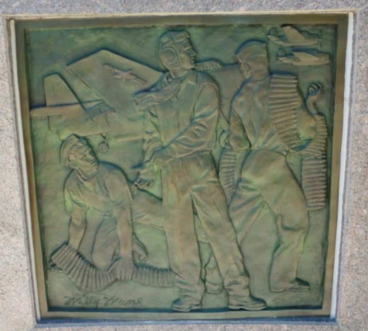 Bas relief showing military service to country.