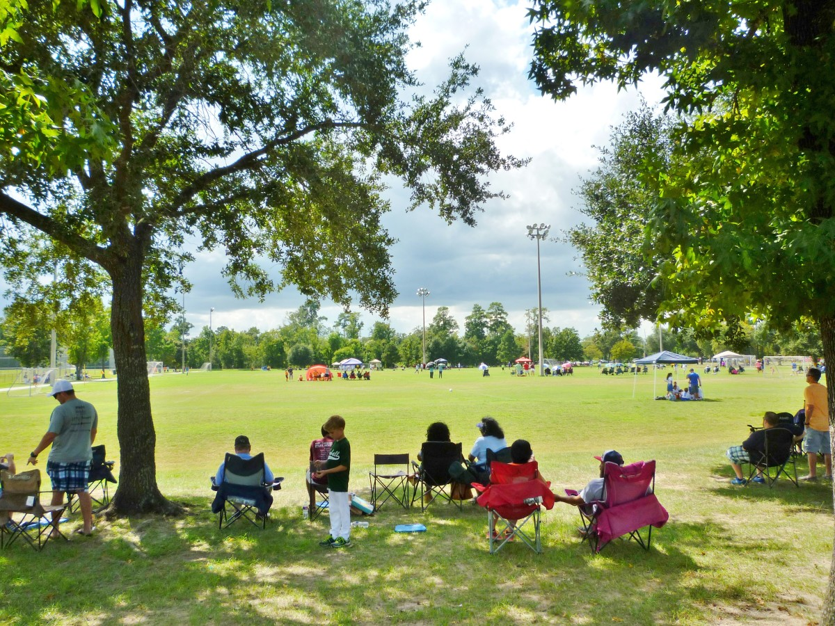 Parents watching kids playing soccer