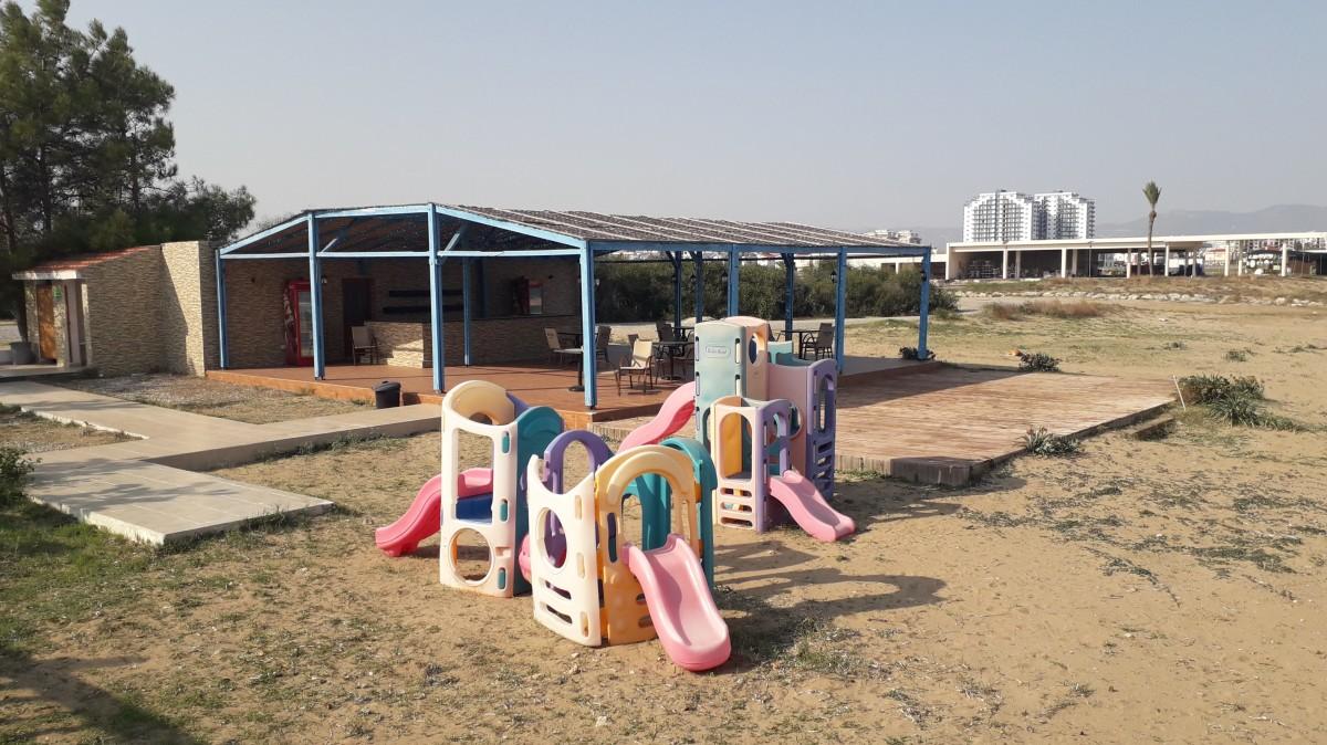 Kids play area and beach bar.