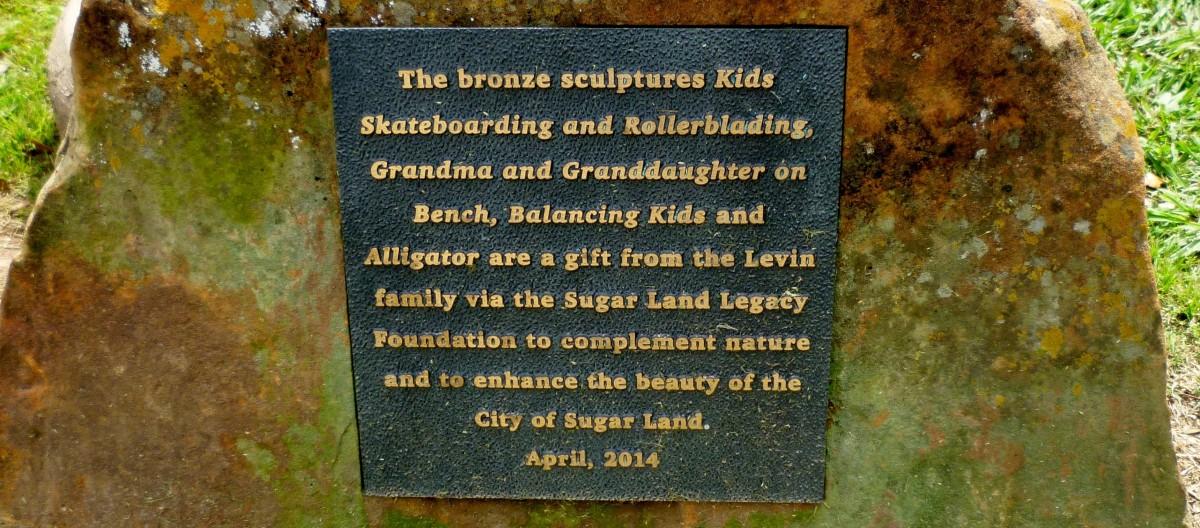 Sign regarding the bronze sculptures in Oyster Creek Park