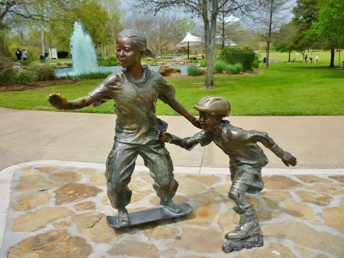Sculptures of Kids Skateboarding and Rollerblading