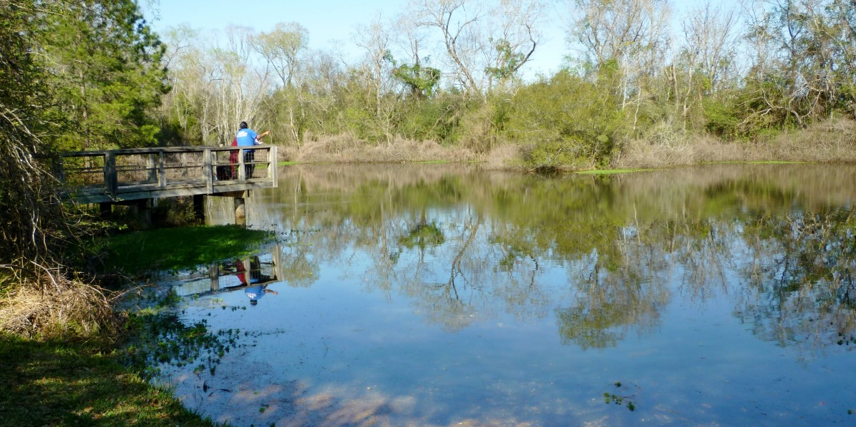 People fishing at the Theis Attaway Nature Center