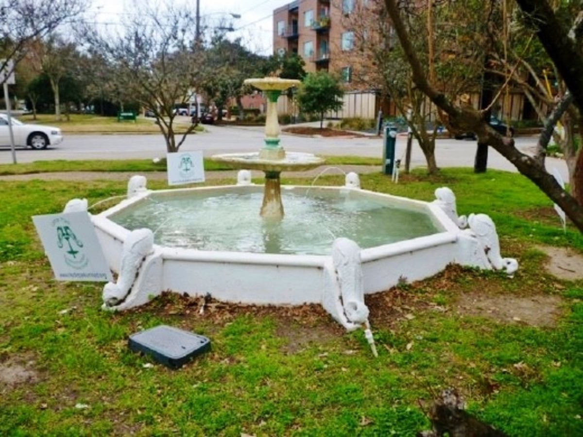 Antique dolphin fountain in need of repair