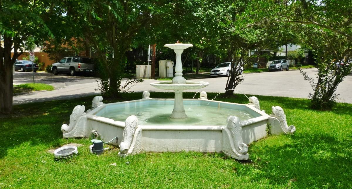 Antique dolphin fountain
