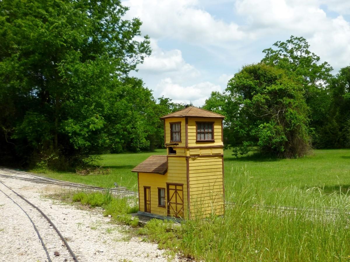 Little building along train tracks