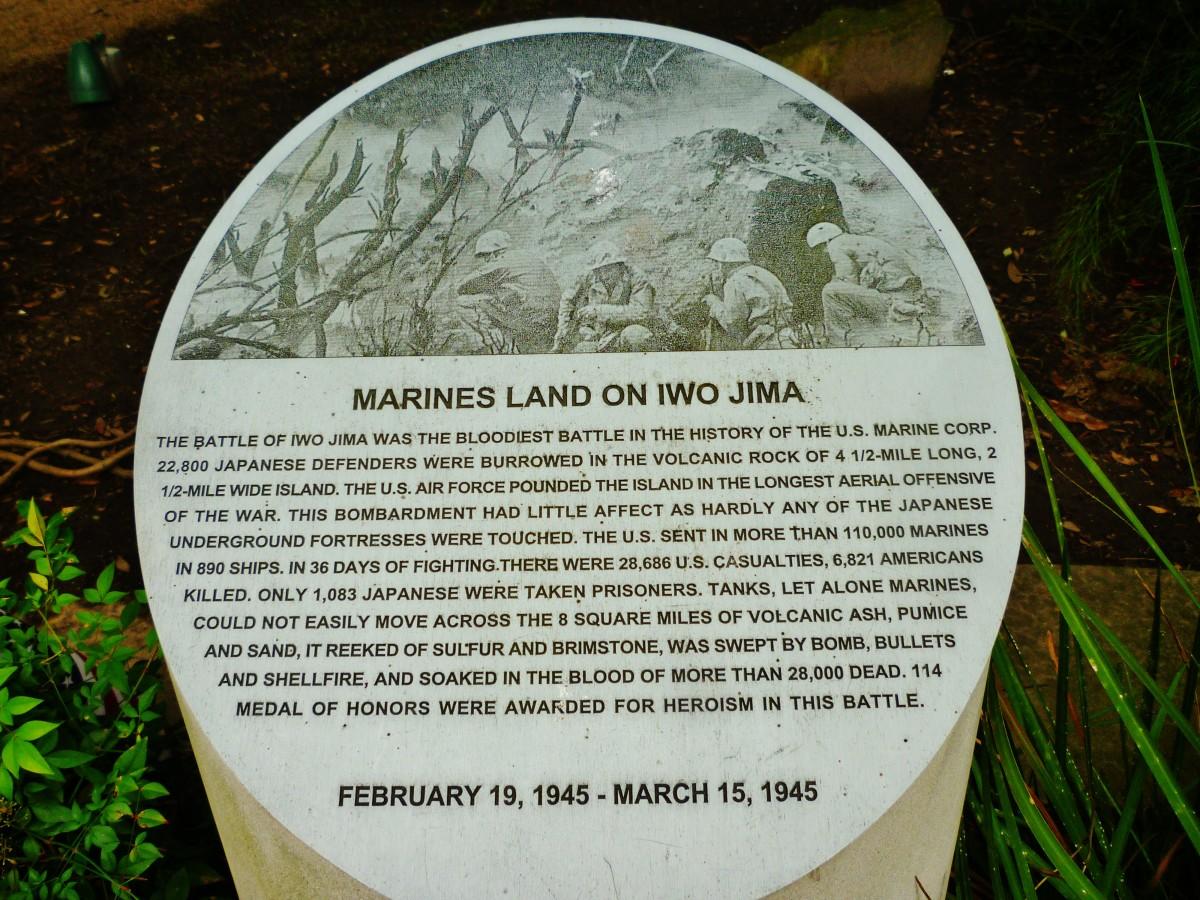 Marines land on Iwo Jima information on a bollard