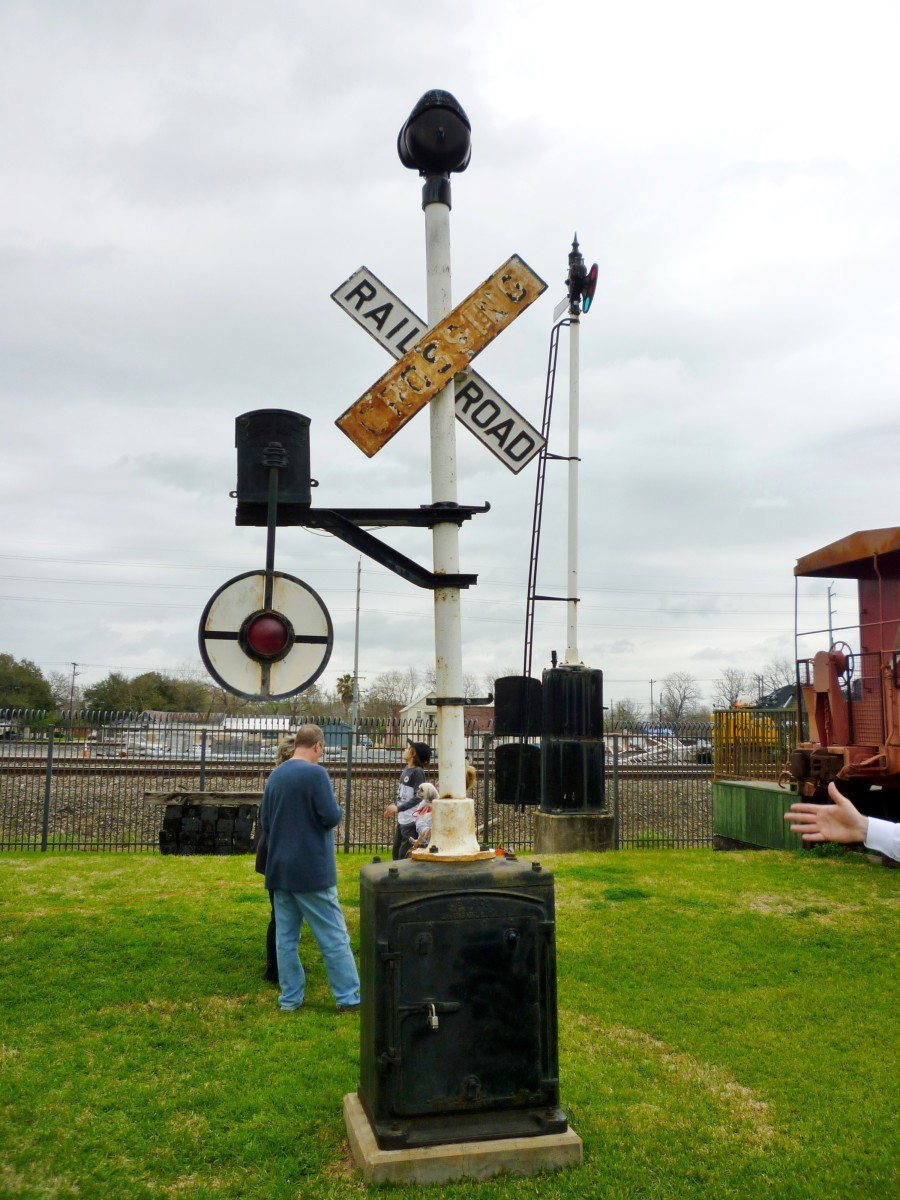 Old railroad crossing signal on display