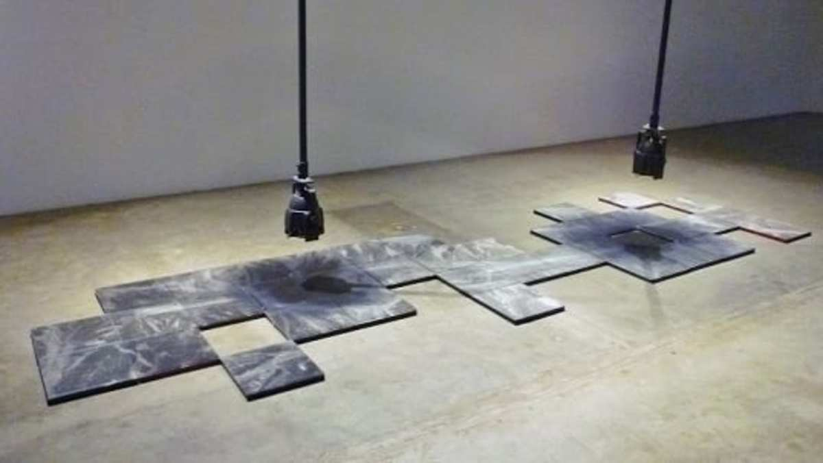 Overhead by artist MPA. Photos of possible UFOs on the floor at CAMH.