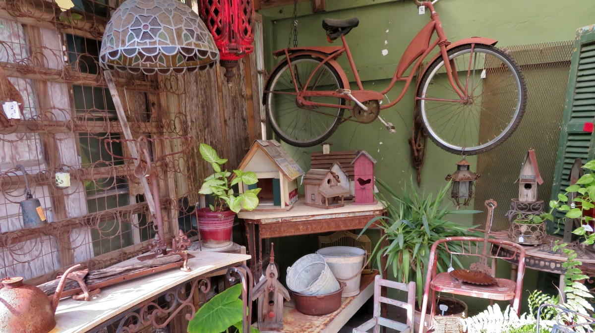 Outdoor area with vintage gardening supplies, plants and more
