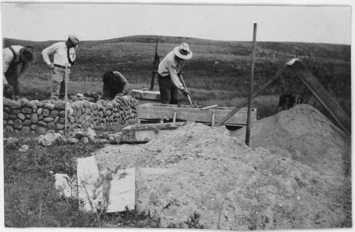 CCC workers building a rock wall