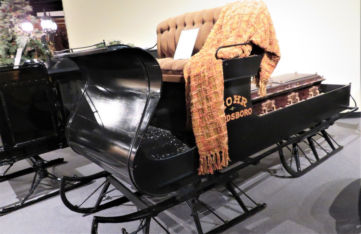 Another horse-drawn sleigh to transport a casket