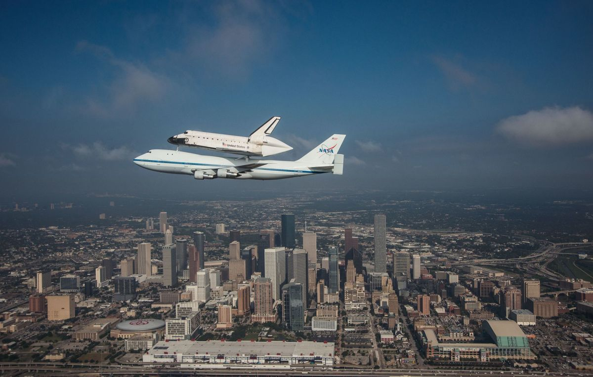 Space Shuttle Endeavour is ferried by NASA's Shuttle Carrier Aircraft (SCA) over Houston, Texas on September 19, 2012