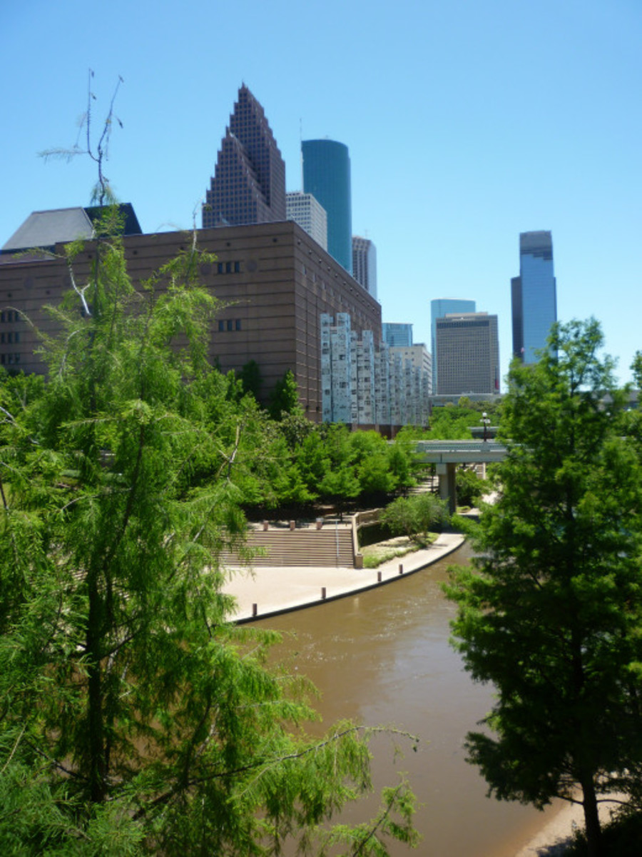 View of the Gus S. Wortham Center (on the left) along Buffalo Bayou in downtown Houston, Texas
