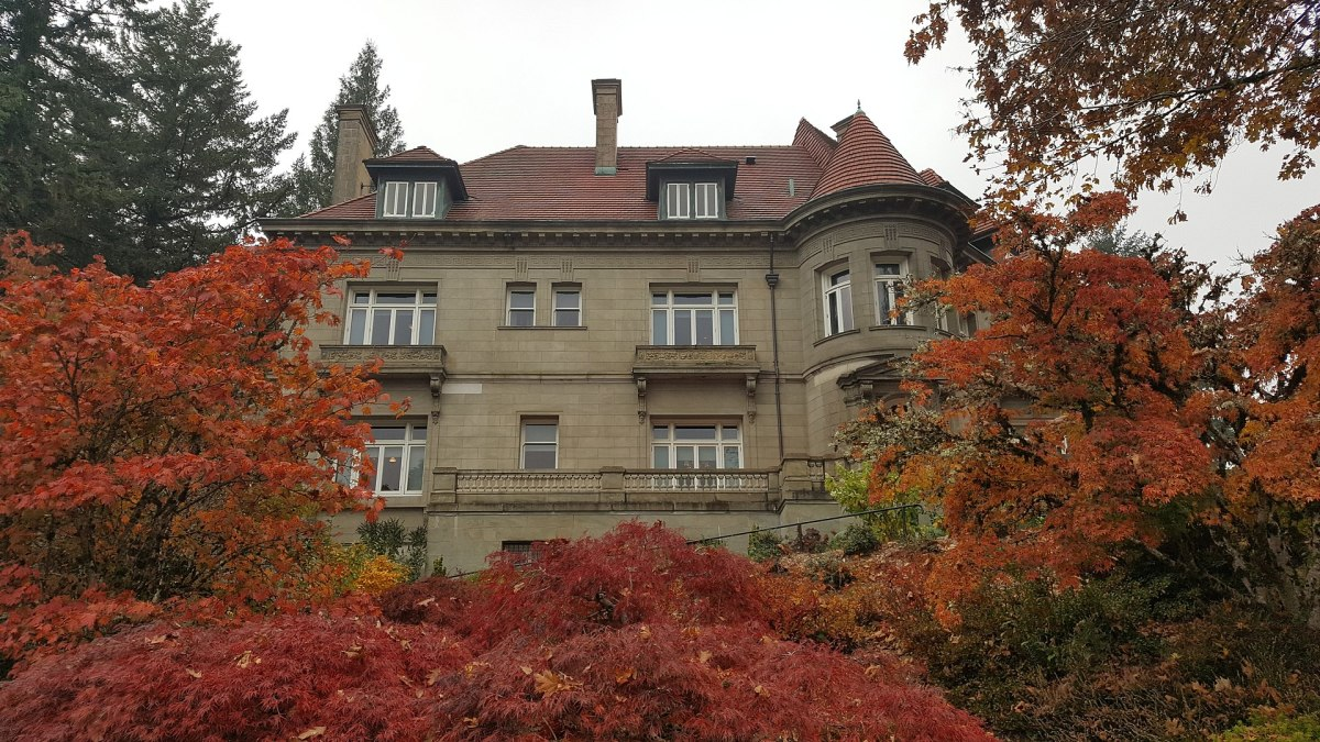 Exterior view of the mansion in the fall season