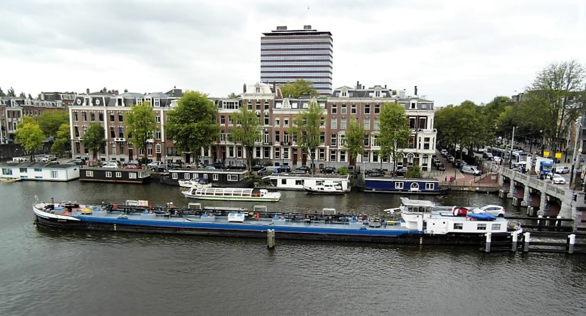 Working barge passing the Amstel Hotel.