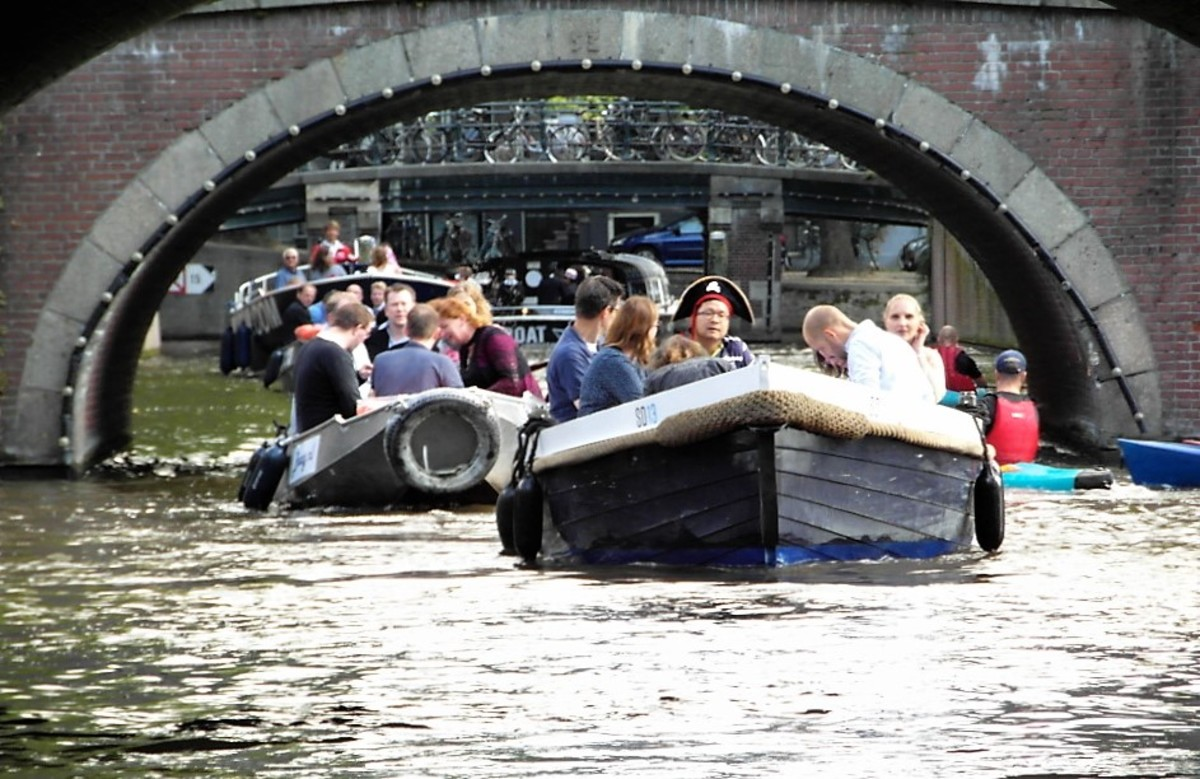 Taking to the water in a motor boat in Amsterdam.