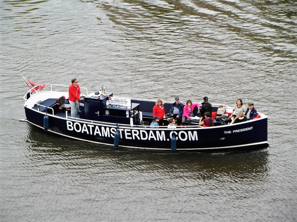 Open boat on the River Amstel.