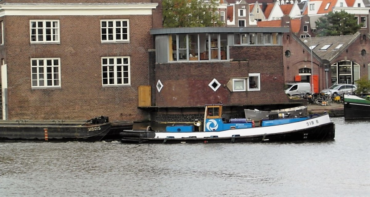 Canal tug boat pulling barges.