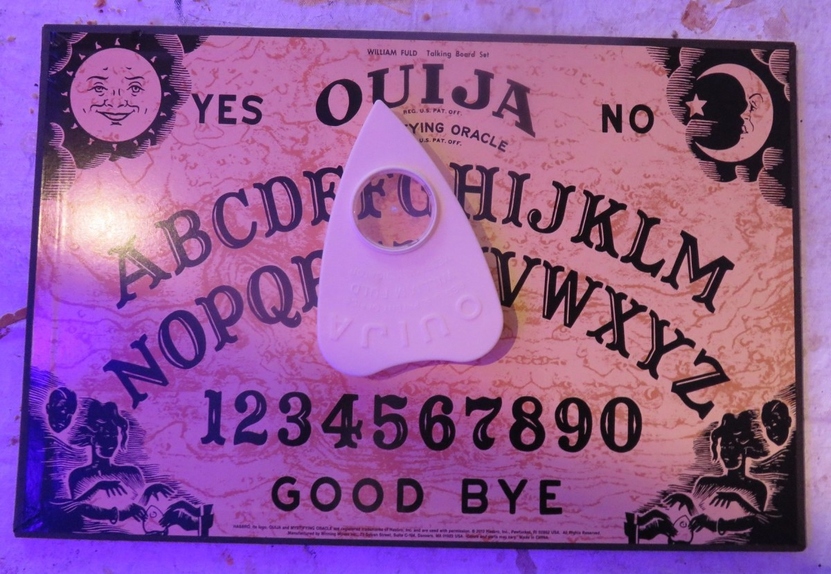 Your homemade Ouija board can be any color you want. Commercial planchettes (pointers) are made of plastic, but you can use any material.