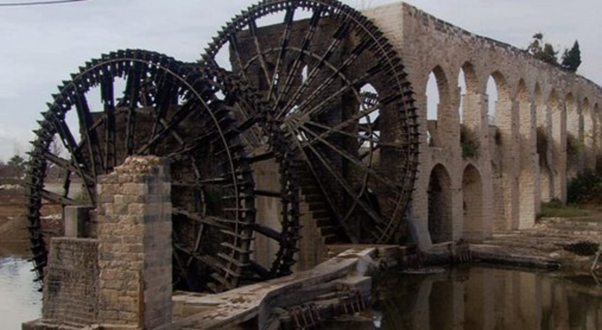 Romans used a water wheel to lift large amounts of water up to the level of their aqueducts that then delivered it by gravity to regions far from the source.