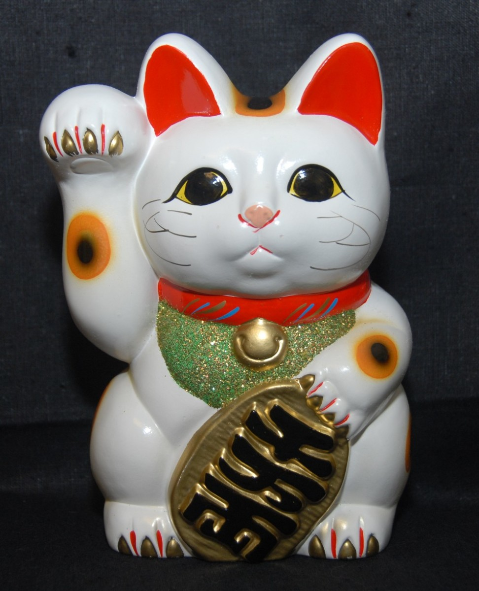 Maneki Neko:  wealth symbol