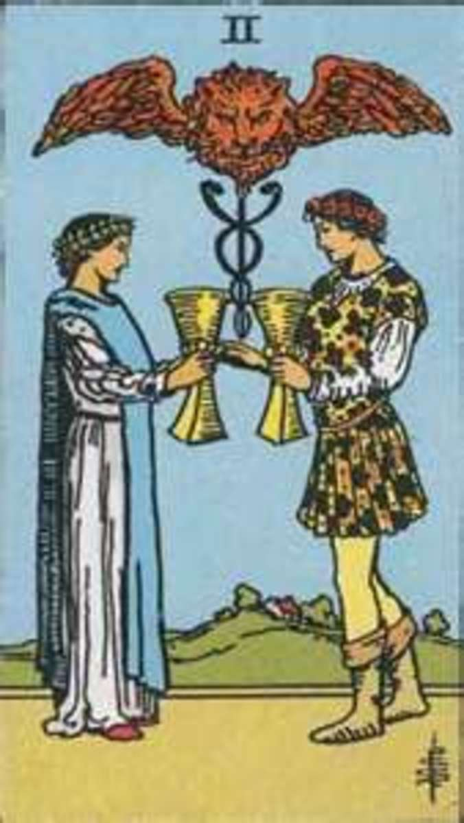 The two of cups shows a happy union, but beware! That sphinx is guarding something... it could be good... it could be bad... only the tarot reader can truly uncover the riddle...