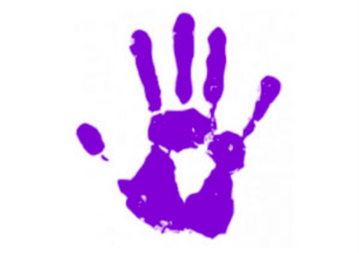A purple handprint could mean a healing touch or spiritual impression.