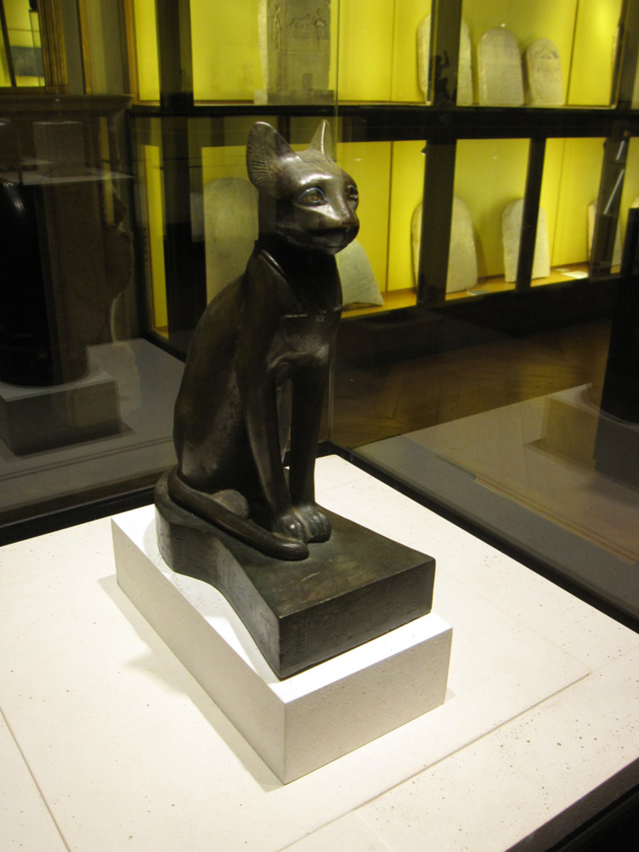 A statue found at Le Louvre depicting the goddess Bast as a cat.