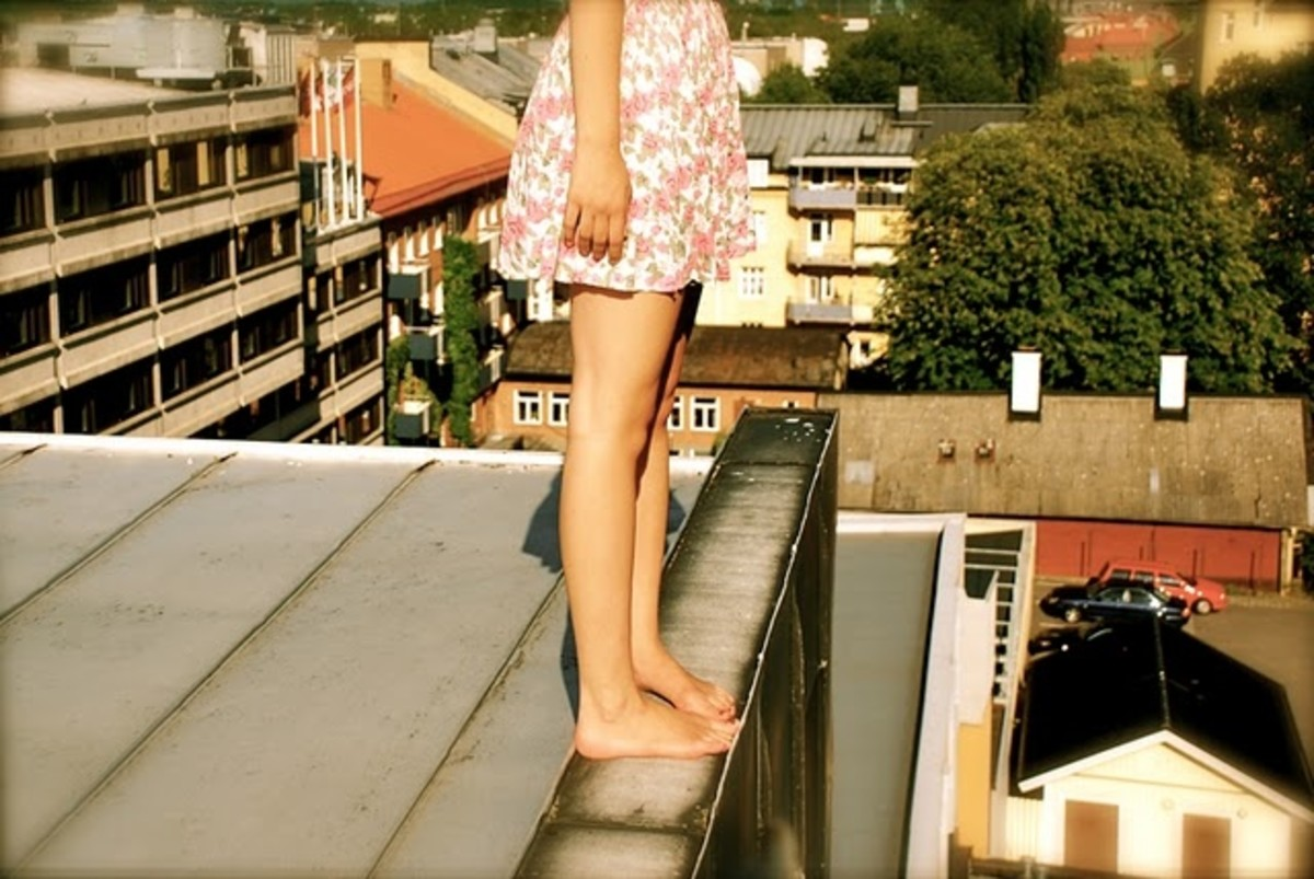 Does Emily stand on the roof and throw rocks down at those below?