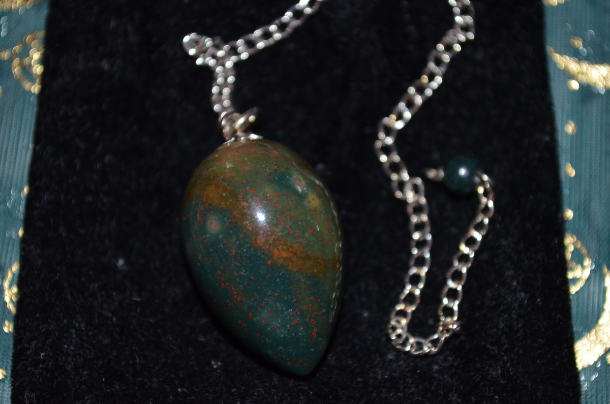 My bloodstone pendulum. A pendulum with a power stone can make it much easier to communicate with a spirit.