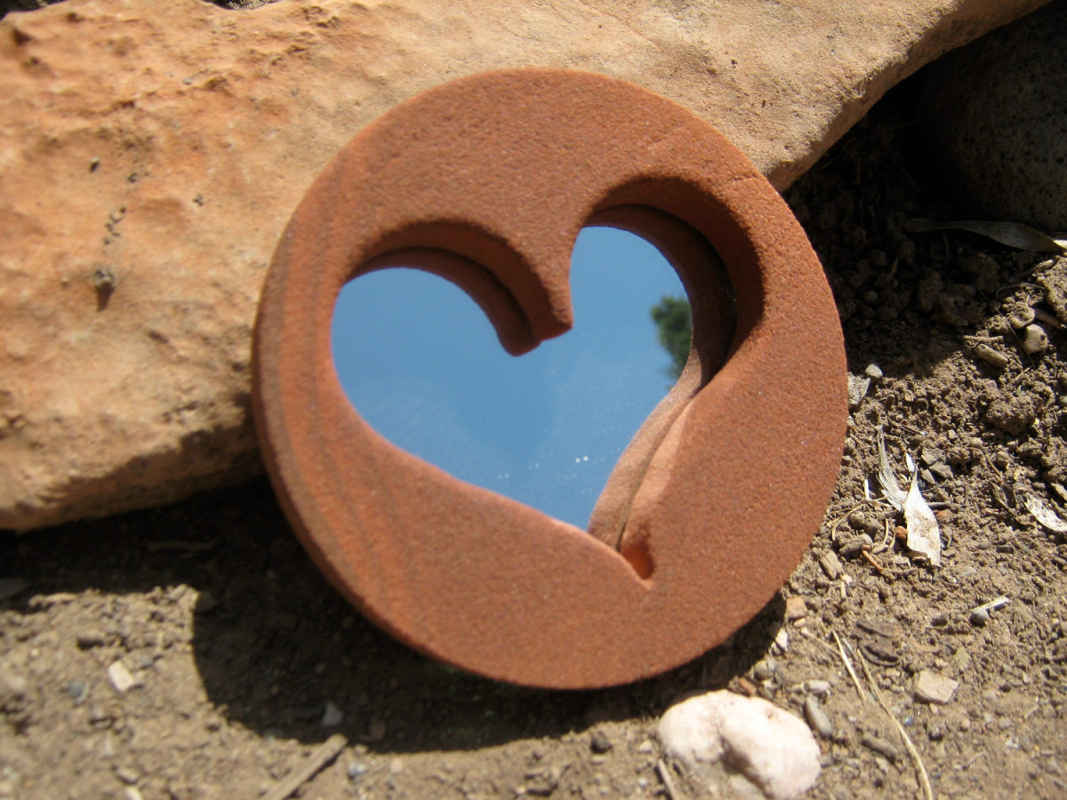 This mirror is unique in that it not only incorporates stone, but a heart. Both work to create peace, love and positive feng shui energies
