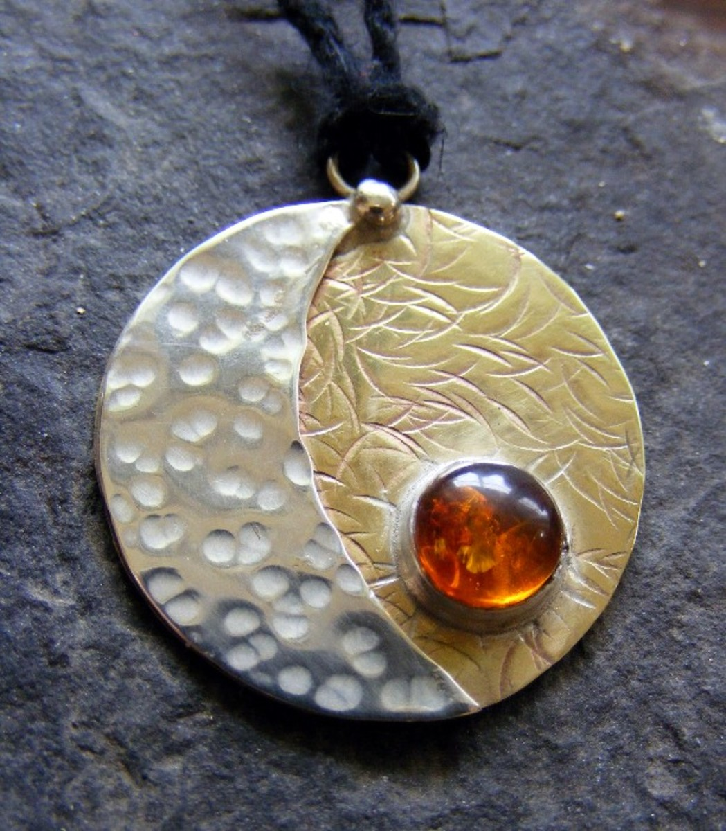 Beautiful Sun-Moon pendant with amber. Amber and gold connect with the energy of the Sun, while  silver keeps in touch with the Moon energy.