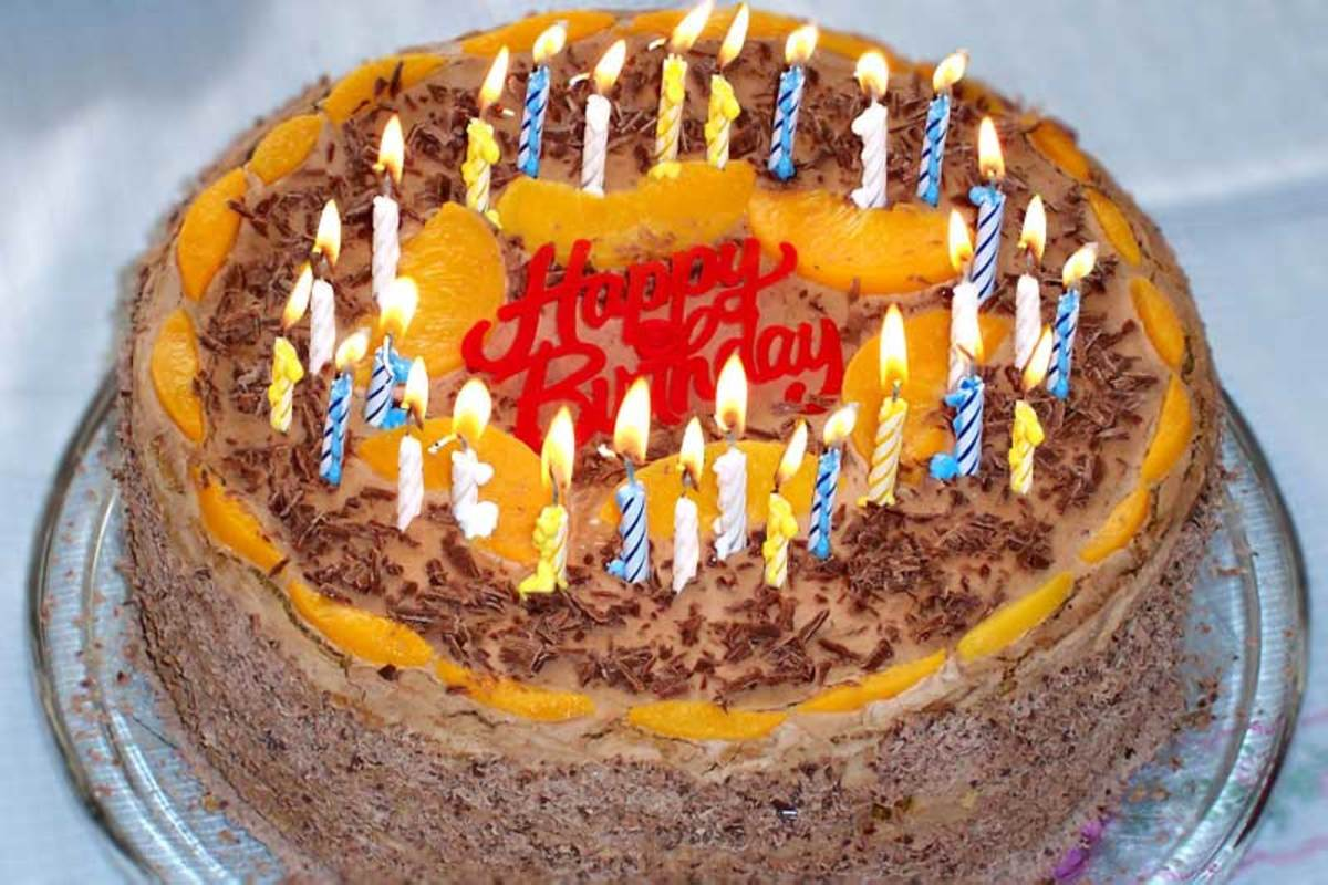 Where does the tradition of blowing out the candles on a birthday cake in one breath come from?