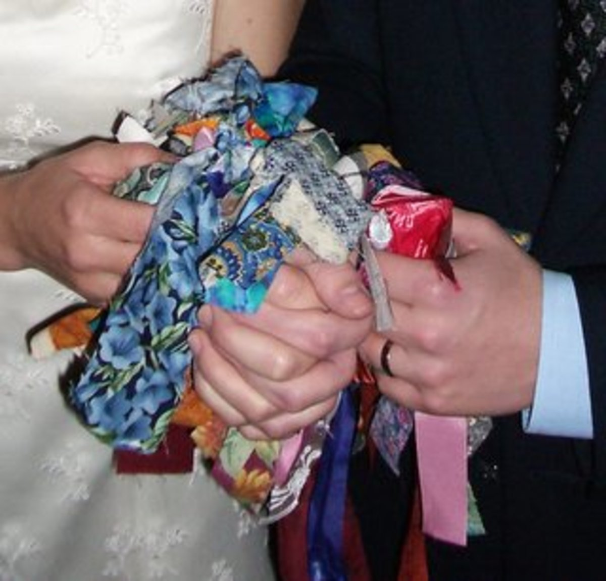 Unconventional handfasting in which each guest tied on a blessed ribbon.