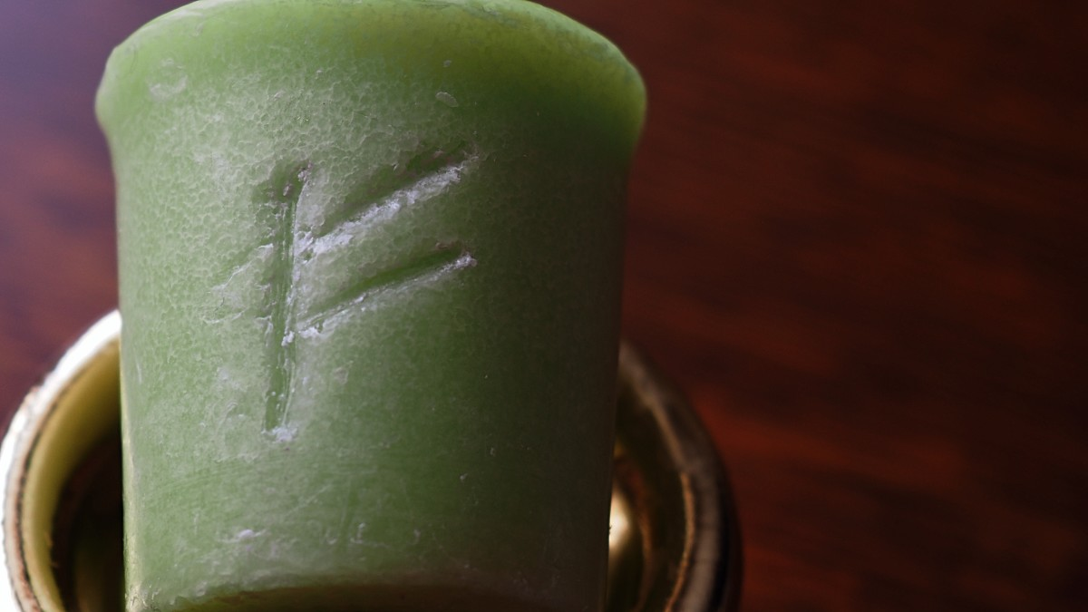 Carving a rune into your candle can help make your spell more powerful. The rune Fehu represents wealth.
