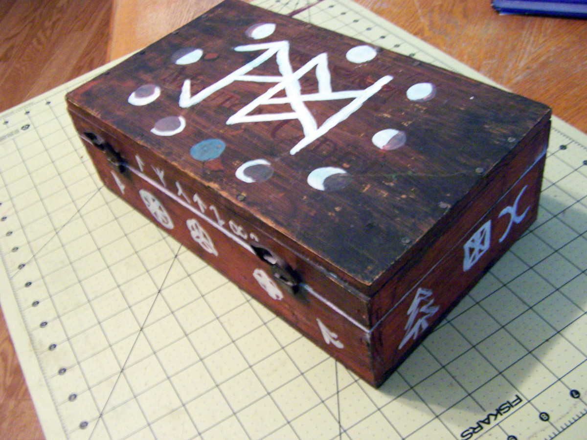 I was given this cigar box ages ago and painted it. I used to use this box to hold my altar supplies like incense and crystals a couple of decades ago, before my collection outgrew it.