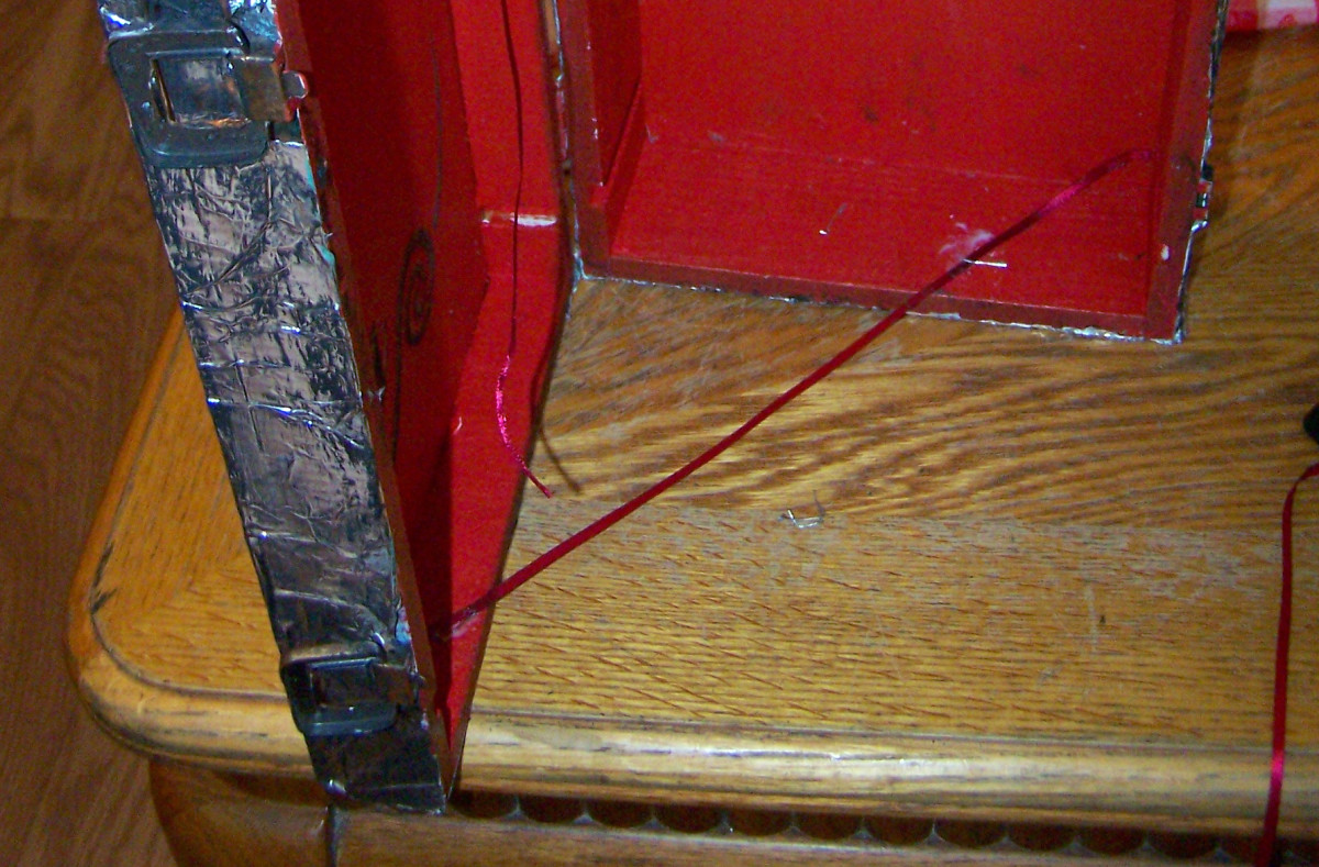 Ribbon hinge stoppers-- the glue will dry clear.