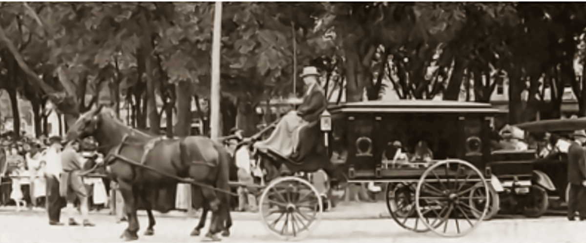 """Horse drawn hearse brings Villisca murder victims to their final resting place. The interment was memorialized as the """"funeral in the park""""."""
