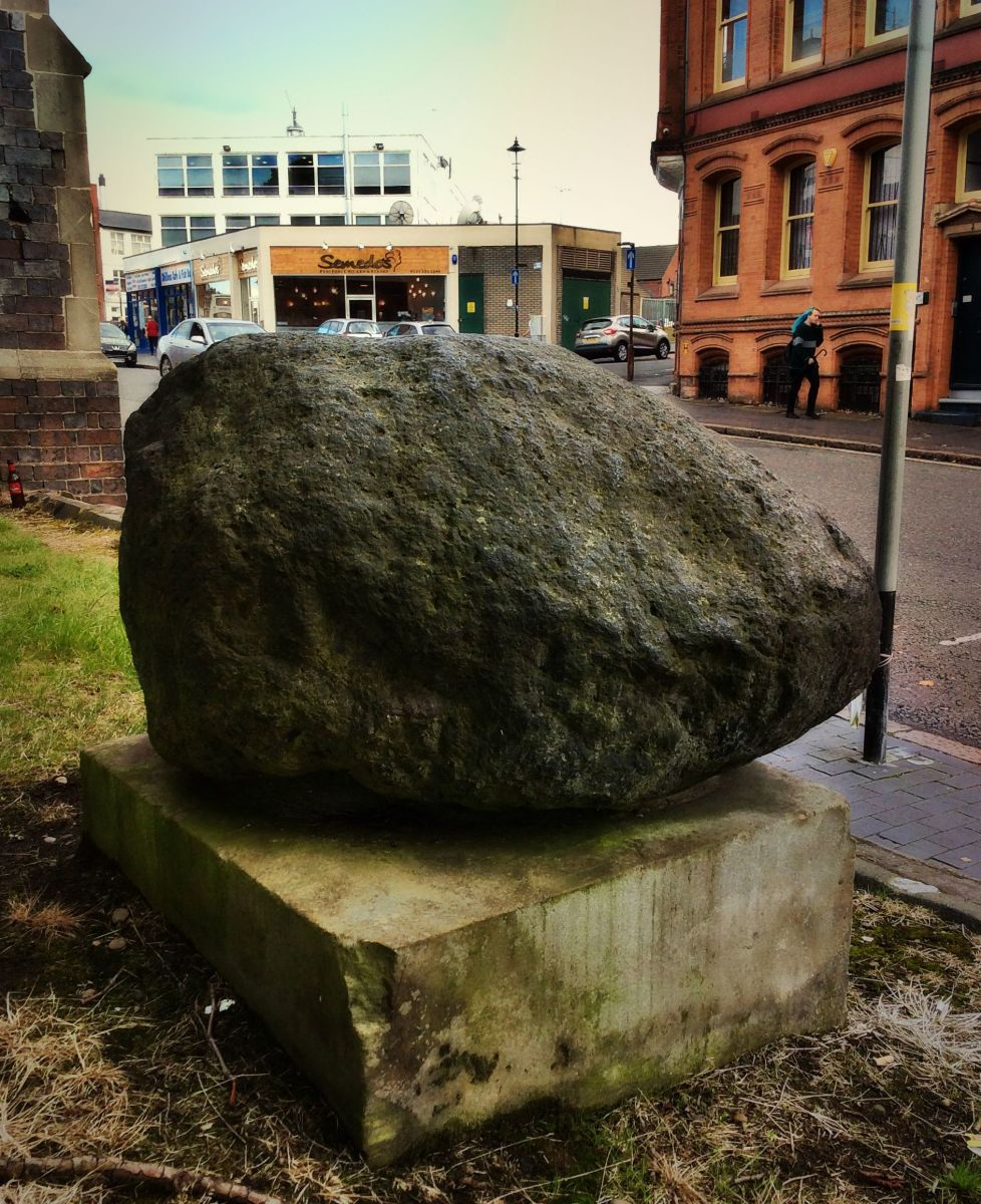 This glacial erratic seems most out of place in its urban setting.