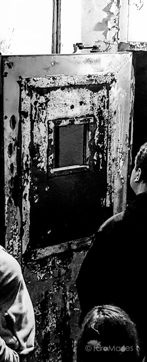 Fourth Floor Door's hatchet marks by alleged trespassers held captive by the shadow people of Waverly Hills Sanatorium
