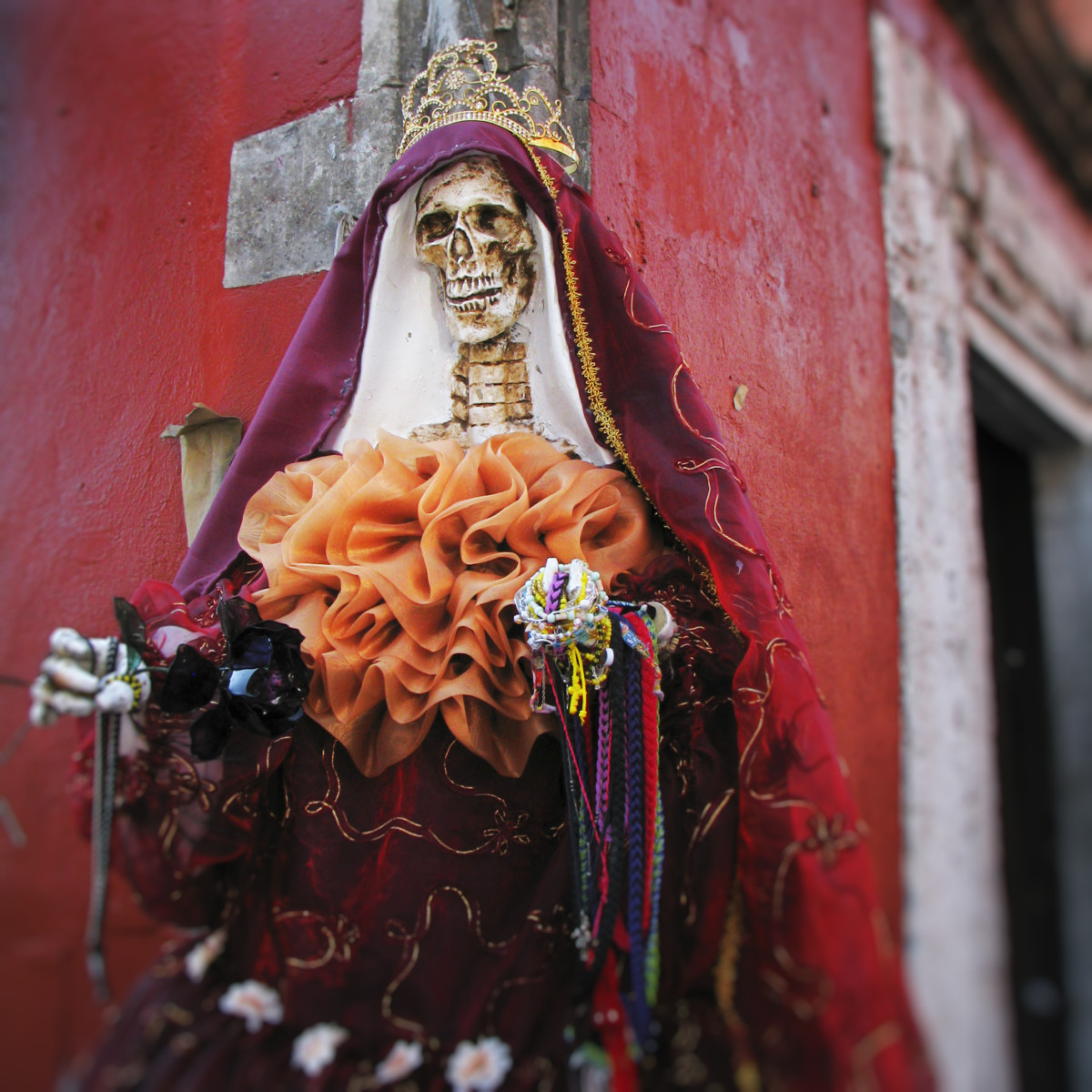 La Santisima Muerte is the Goddess of Death.  Her image should be feminine ... the more feminine and beautiful, the better.