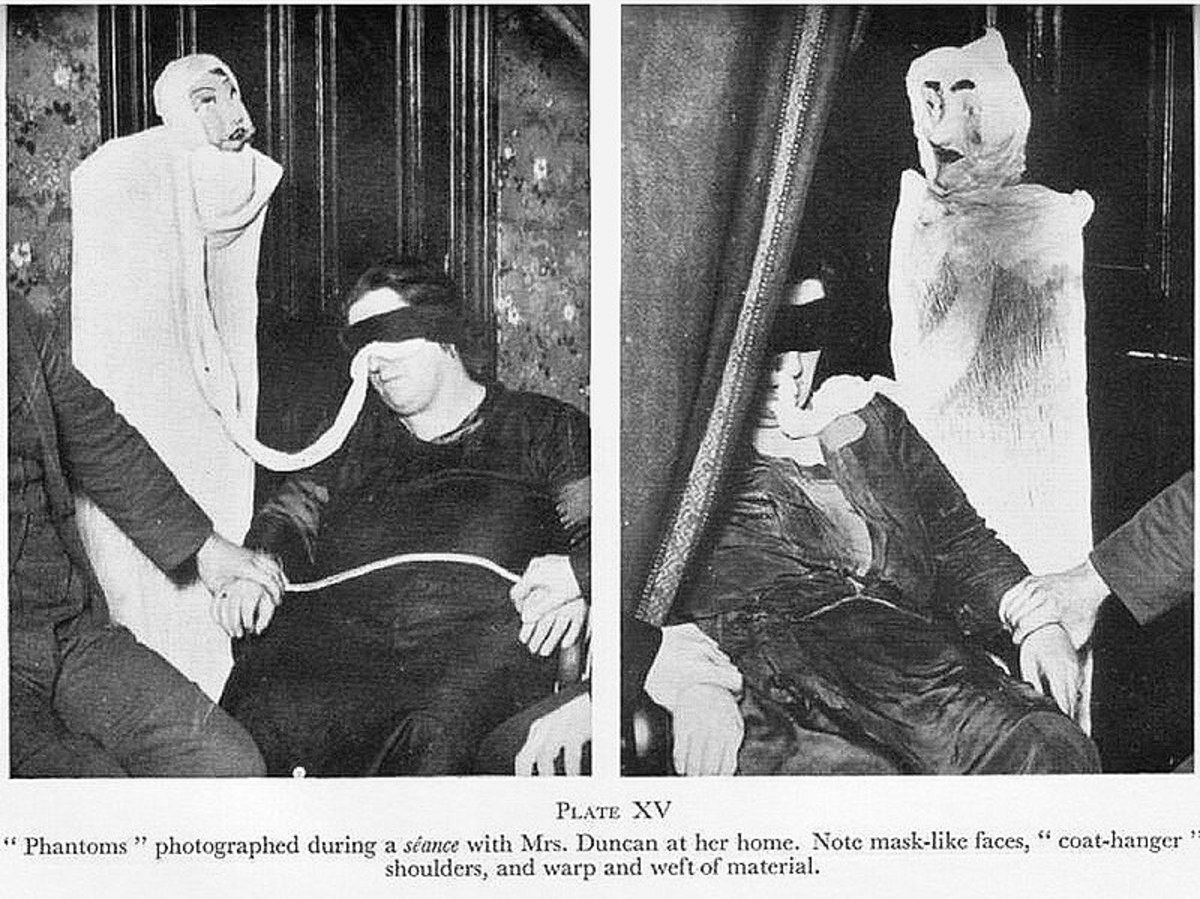Helen Duncan performs the old ectoplasm/cheesecloth illusion and conjures up strange looking effigies.