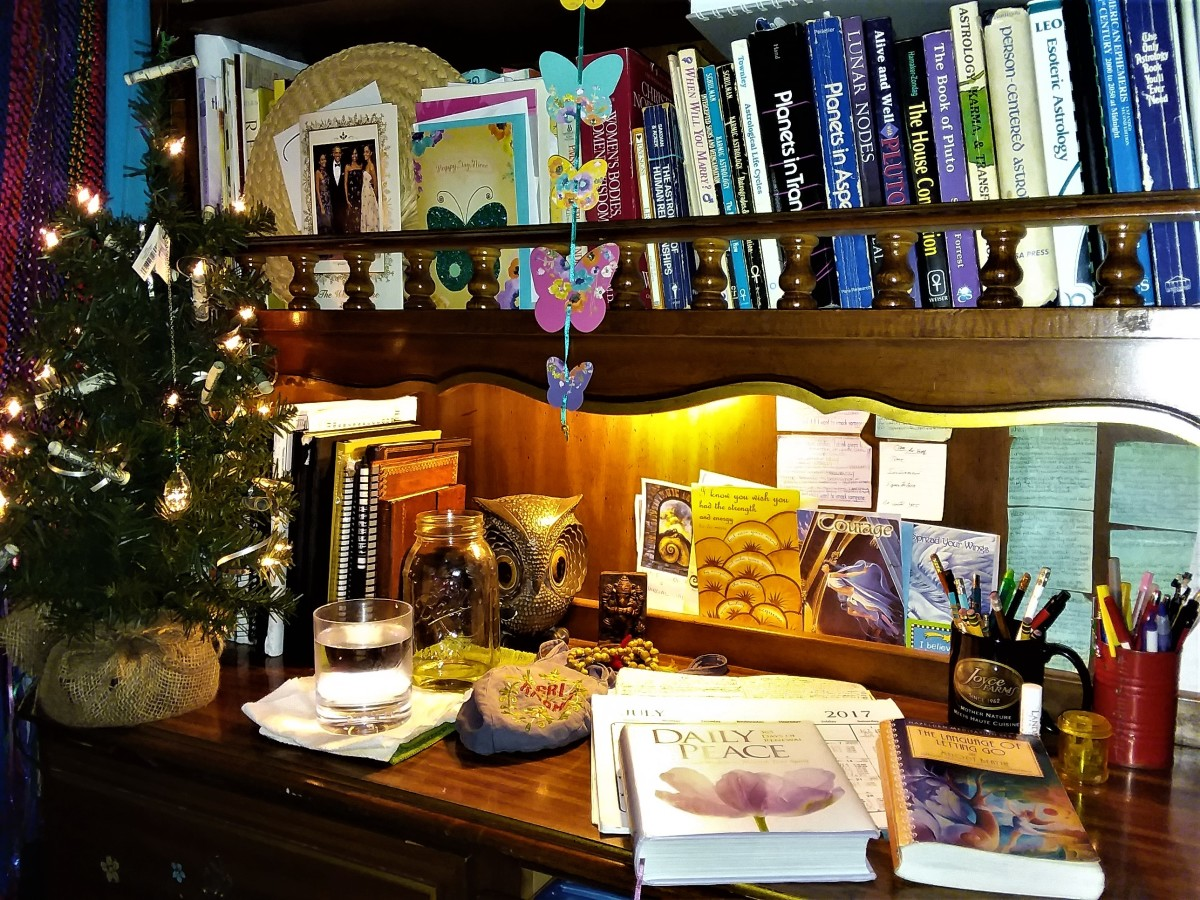 Here is the little desk I've had since age 15 that I go to every day for my morning meditation. This includes my astrology and some other books with a myriad other little healthy items of inspiration.