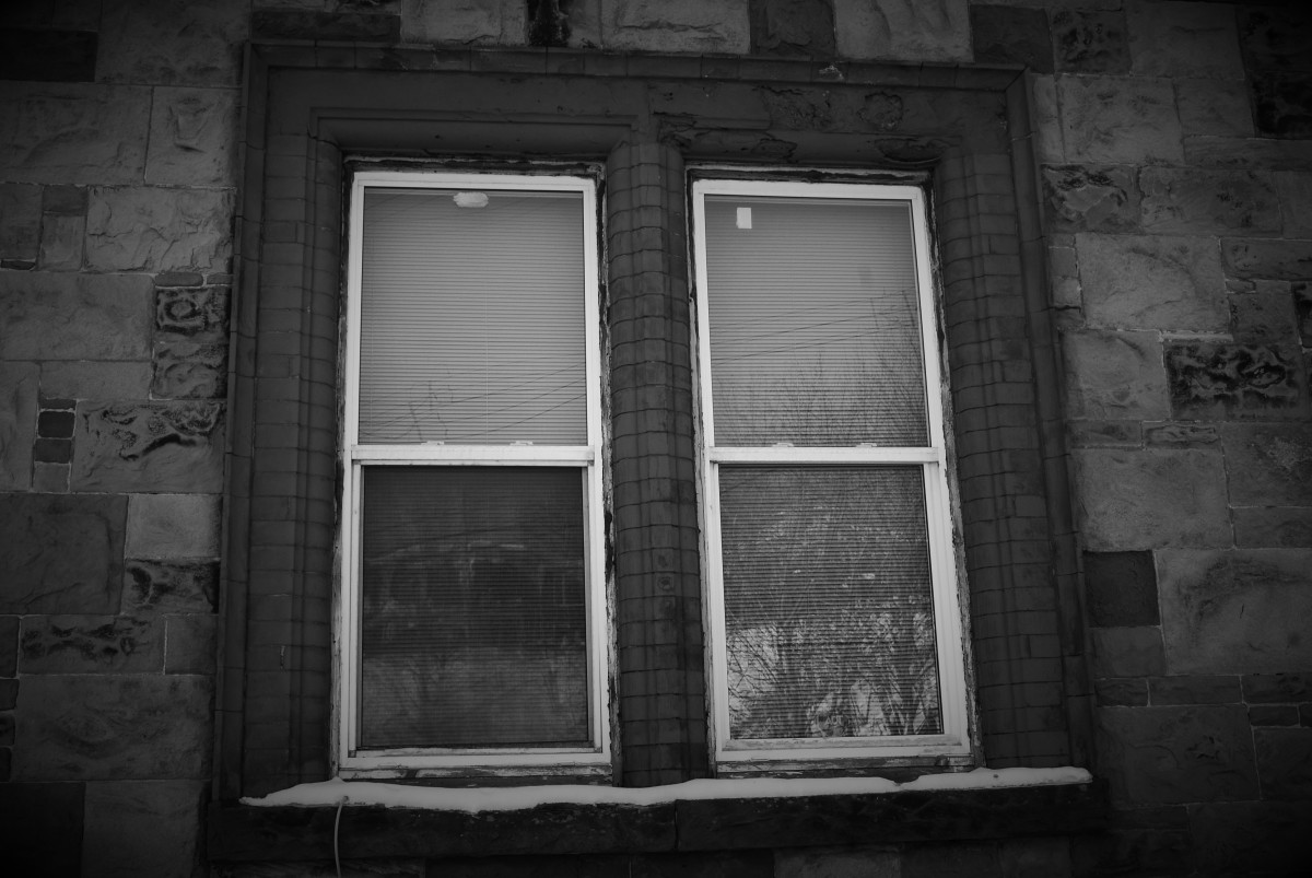 The window where, for Years, people have reported seeing the ghostly image of an old woman looking out at the street.