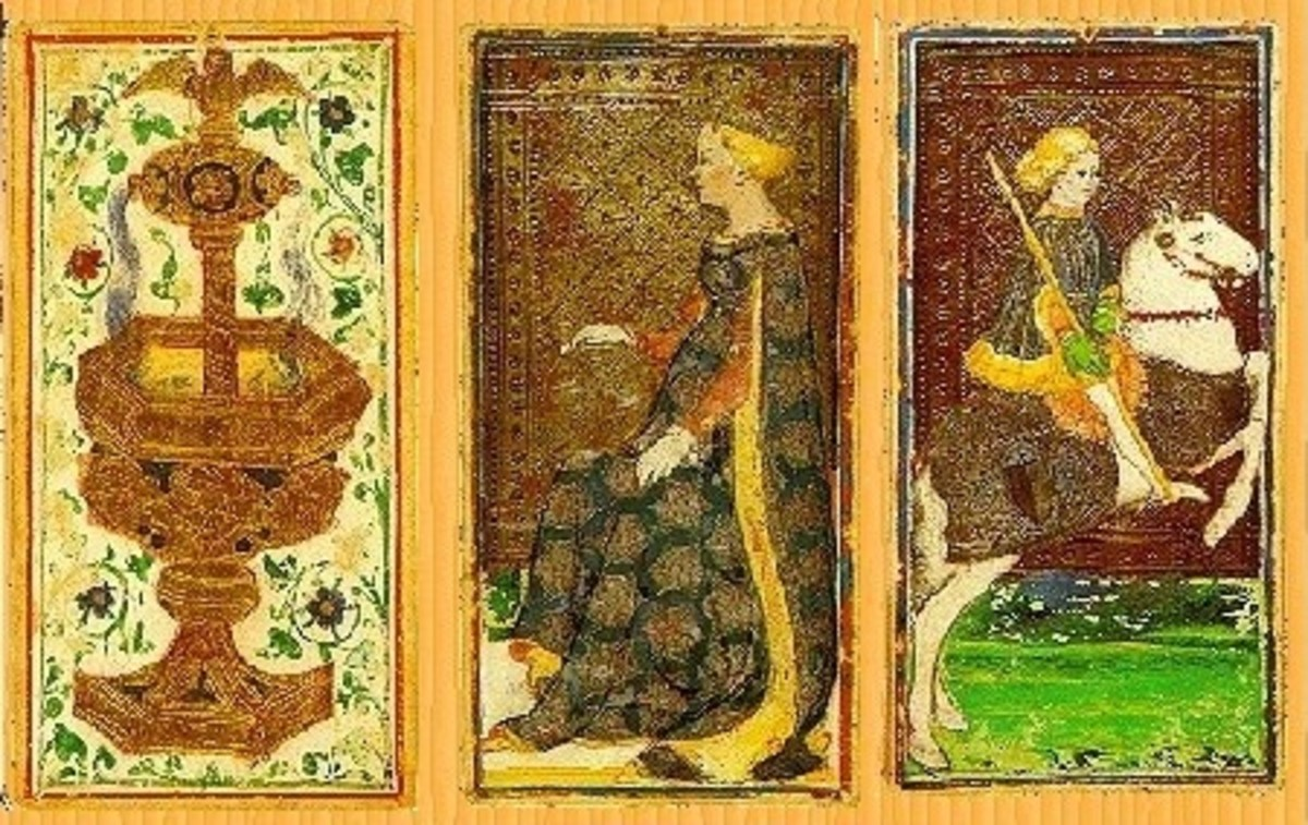 Three cards from an original Visconti-Sforza deck created mid 15th century